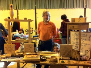 Hand made wooden craft items for sale at a craft fair